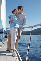 Couple Standing on Side of Sailboat