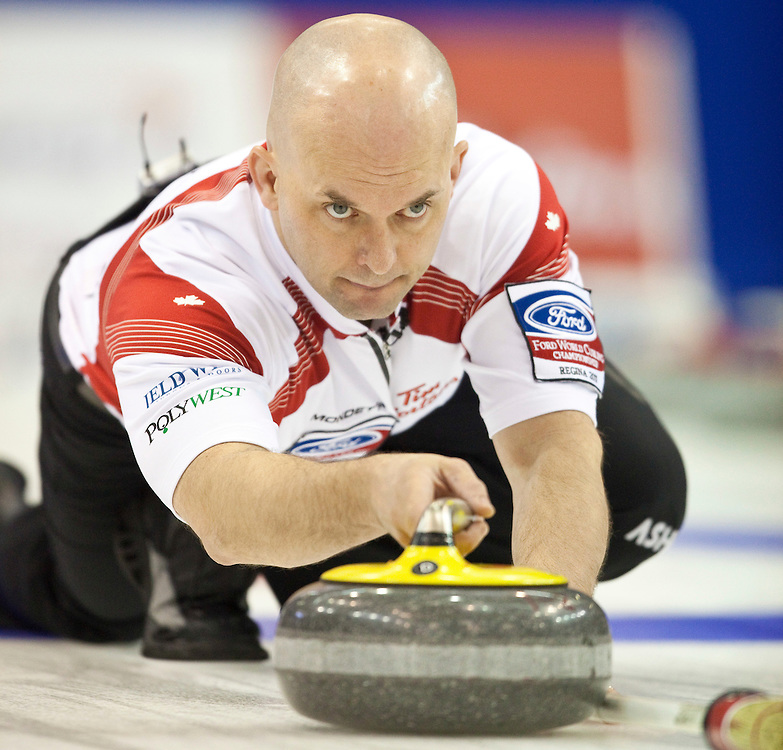 Canadian third Jon Mead delivers his stone during the gold medal game against Scotland at the Ford World Men's Curling Championships in Regina, Saskatchewan, April 10, 2011.<br /> AFP PHOTO/Geoff Robins