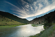 Idaho, Frank Church Wilderness. Clouds over Main Salmon near Shoup at sunset.