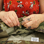 JUNE 28, 2016 --- COROZAL, PUERTO RICO<br /> The hands of Socorro Lebron, a final inspector at Bluewater Defense, giving pants one last look before sending them to packaging. The company makes pants for the US Army.<br /> (Photo by Angel Valentin/Freelance)