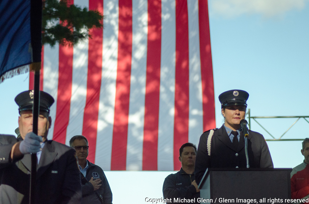 1 Oct 2017 Elmont, New York United States of America // FDNY EMT Sarah McShane from FDNYEMS Star 32 sings the National Anthem at the ceremony to start the 3RD annual national stair climb for fallen firefighters at the Belmont Park racetrack  Michael Glenn  /   for the FDNY