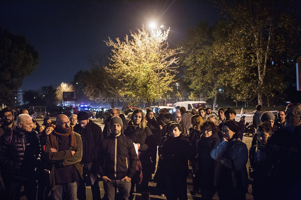 ROME, ITALY - 25 NOVEMBER 2014: Residents of Tor Sapienza, the working-class neighborhood in the outskirts of Rome, gather for a public assembly to discuss about integration after the acts of violence againt refugees, in Rome, Italy, on November 25th 2014. Tor Sapienza has seen several days and nights of violence against refugees by residents who blame foreigners for crimes.
