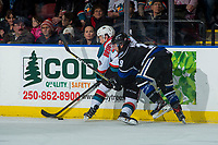 KELOWNA, CANADA - DECEMBER 30: Conner Bruggen-Cate #20 of the Kelowna Rocketsis checked by Dante Hannoun #19 of the Victoria Royals on December 30, 2017 at Prospera Place in Kelowna, British Columbia, Canada.  (Photo by Marissa Baecker/Shoot the Breeze)  *** Local Caption ***