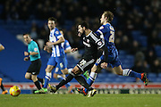 Brentford defender Yoann Barbet challenged by Brighton striker (on loan from Manchester United), James Wilson (21) during the Sky Bet Championship match between Brighton and Hove Albion and Brentford at the American Express Community Stadium, Brighton and Hove, England on 5 February 2016.