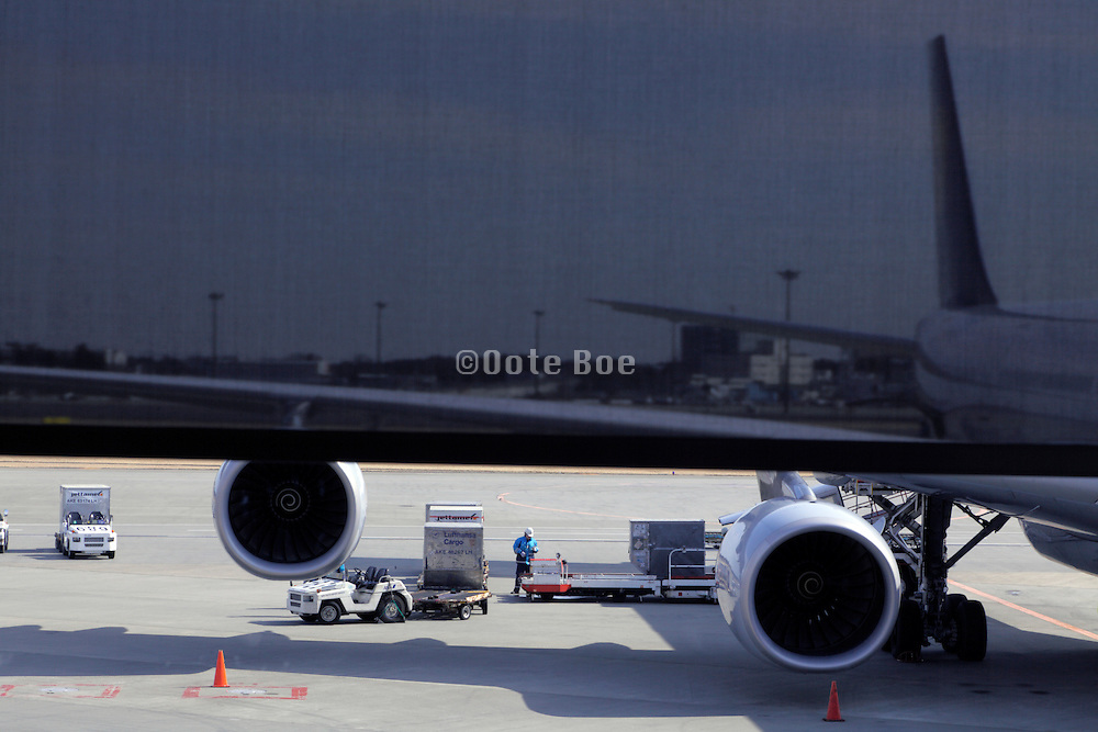 passenger airplane being prepared for the next flight with a window screen in the image