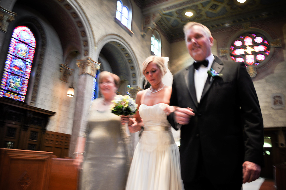 Jane's mother & father walk her down the isle at St. Giles Catholic Church in Oak Park, IL