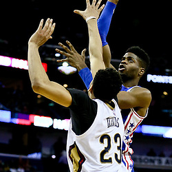 Feb 19, 2016; New Orleans, LA, USA; Philadelphia 76ers forward Nerlens Noel (4) shoots over New Orleans Pelicans forward Anthony Davis (23) during the second half of a game at the Smoothie King Center. The Pelicans defeated the 76ers 121-114. Mandatory Credit: Derick E. Hingle-USA TODAY Sports