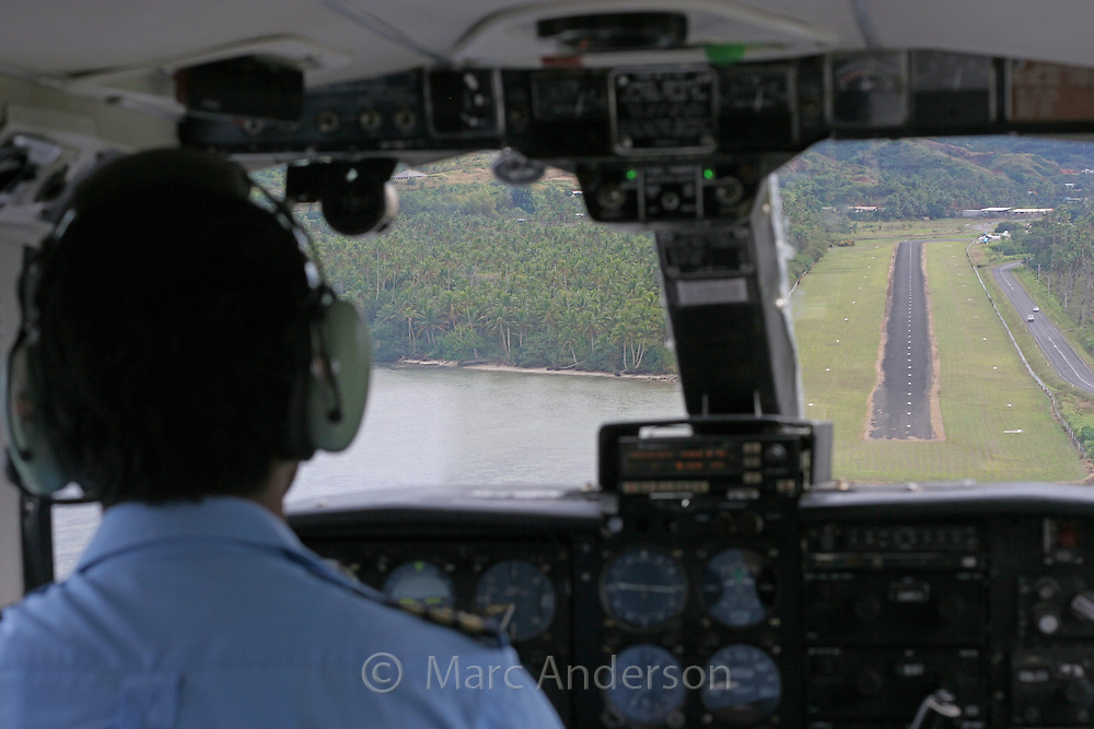 A pilots view as he is about to land a small plane on a runway in Fiji.