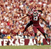 Oct 20, 2012; College Station, TX, USA; Texas A&M Aggies wide receiver Mike Evans (13) and quarterback Johnny Manziel (2) celebrate a big play against the LSU Tigers during the first half at Kyle Field. Mandatory Credit: Thomas Campbell