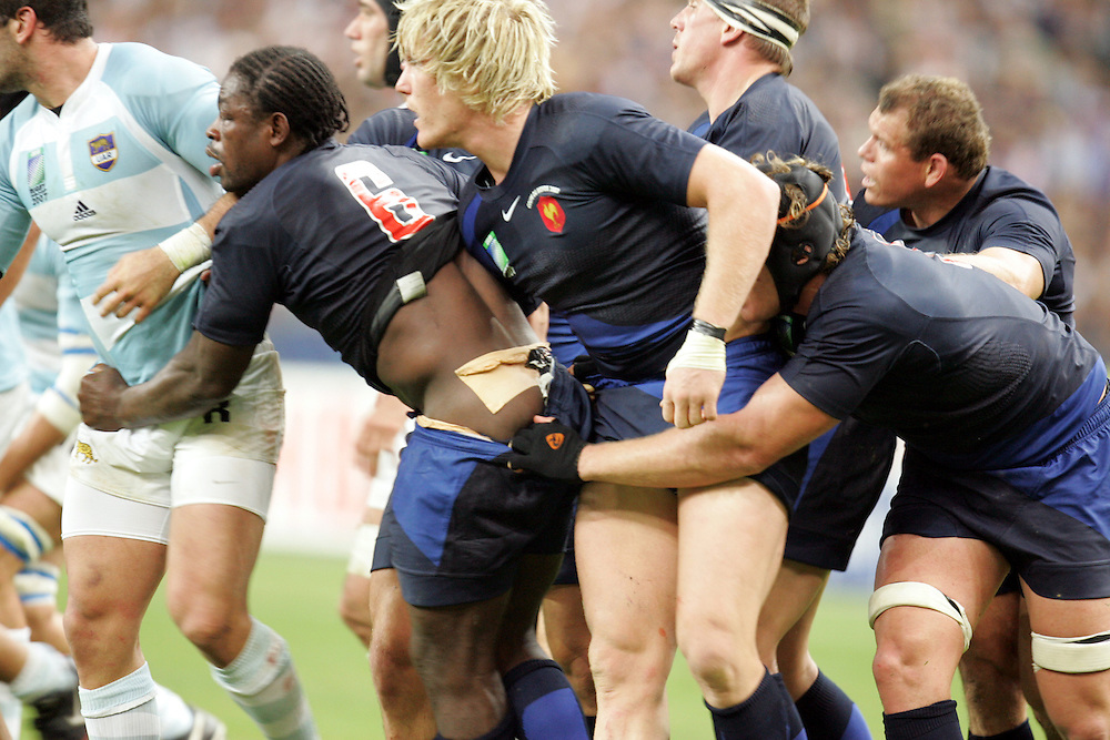 Serge Betsen of France has his shorts pulled down in the opening game of the World Cup 2007. Stade de France, St Denis. 7/09/07