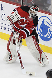 Apr 7; Newark, NJ, USA; New Jersey Devils goalie Martin Brodeur (30) plays the puck during the second period of their game against the Ottawa Senators at the Prudential Center.