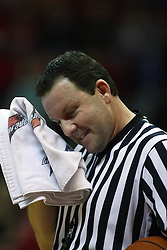 11 December 2010: Referee Brad Gaston during an NCAA basketball game between the Illinois - Chicago Flames (UIC) and the Illinois State Redbirds (ISU) at Redbird Arena in Normal Illinois.