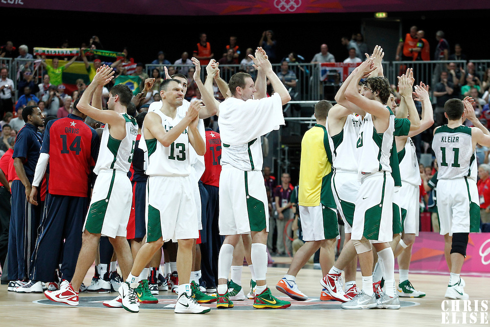 04 August 2012: Lithuania players thank the fans during 99-94 Team USA victory over Team Lithuania, during the men's basketball preliminary, at the Basketball Arena, in London, Great Britain.