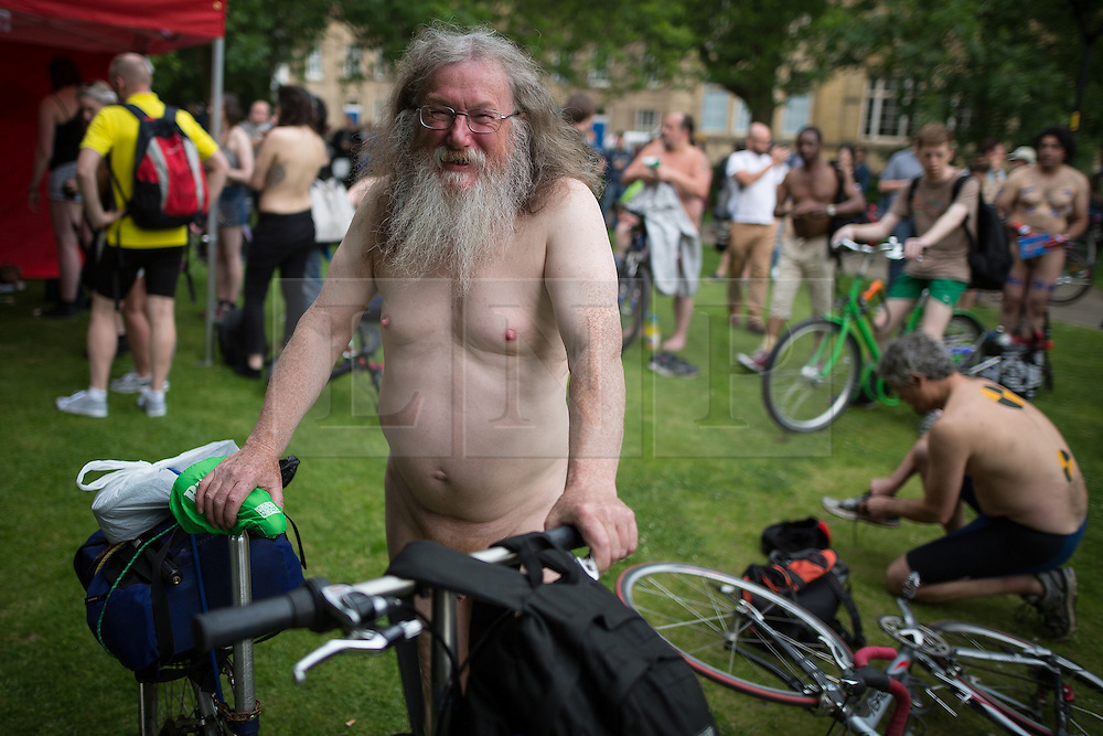© Licensed to London News Pictures. 12/06/2015. Manchester, UK. Hundreds take part in the World Naked Bike Ride , which sees cyclists undress and cycle nude through Manchester City Centre . Photo credit: Joel Goodman/LNP