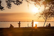 Fishing at sunset on the north shore of Lake Pontchartrain near Lakeshore Drive in Mandeville, Louisiana