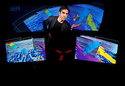 Founder/Owner of Magic Earth in Front of Computer Monitors