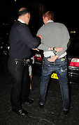 11.NOVEMBER.2008. LONDON<br /> <br /> WEST HAM FOOTBALLER JAMES COLLINS LEAVES FUNKY BUDDAH IN HANDCUFFS AT 3.00AM. HE WAS ARRESTED BY AN UNDERCOVER POLICEMAN AFTER A FIGHT WITH A FELLOW CLUB GOER. MAYFAIR, LONDON<br /> <br /> BYLINE: EDBIMAGEARCHIVE.CO.UK<br /> <br /> *THIS IMAGE IS STRICTLY FOR UK NEWSPAPERS AND MAGAZINES ONLY*<br /> *FOR WORLD WIDE SALES AND WEB USE PLEASE CONTACT EDBIMAGEARCHIVE - 0208 954 5968*
