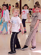 (from left) Kierra Low, 8; Miles Boston, 5; Ryley Lamb, 8 and Alexander Zook, 6 during the first of six hip-hop dance classes at the Carnegie Center in Miamisburg , Saturday, January 28, 2012.
