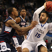 Marquel Curtis, (right), Tulsa, is defended by Ryan Boatright, UConn, during the UConn Huskies Vs Tulsa Semi Final game at the American Athletic Conference Men's College Basketball Championships 2015 at the XL Center, Hartford, Connecticut, USA. 14th March 2015. Photo Tim Clayton