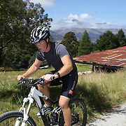A competitor in action during the bike leg of the Paradise Triathlon and Duathlon series, Paradise, Glenorchy, South Island, New Zealand. 18th February 2012. Photo Tim Clayton
