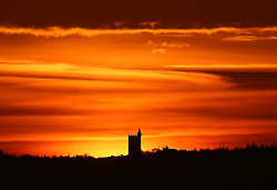 © Licensed to London News Pictures. 02/10/2014. Somerset, UK King Alfred's Tower at Stourhead in Somerset silhouetted by the rising sun this morning 2nd October 2014. Photo credit : Jason Bryant/LNP