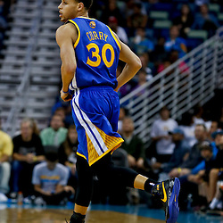 Mar 18, 2013; New Orleans, LA, USA; Golden State Warriors point guard Stephen Curry (30) against the New Orleans Hornets during the second half of a game at the New Orleans Arena. The Warriors defeated the Hornets 93-72.  Mandatory Credit: Derick E. Hingle-USA TODAY Sports
