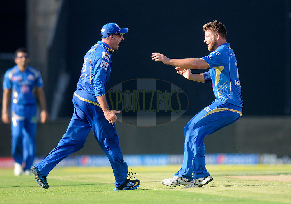 Corey Anderson of the Mumbai Indians celebrates the wicket of Quinton de Kock of the Delhi Daredevils during match 16 of the Pepsi Indian Premier League 2014 between the Delhi Daredevils and the Mumbai Indians held at the Sharjah Cricket Stadium, Sharjah, United Arab Emirates on the 27th April 2014<br /> <br /> Photo by Pal Pillai / IPL / SPORTZPICS
