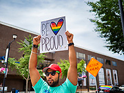 "28 JUNE 2020 - DES MOINES, IOWA: NAREN BHOJWANI cheers during the Capitol City Pride Parade in Des Moines. Most of the Pride Month events in Des Moines were cancelled this year because of the COVID-19 pandemic, but members of the Des Moines LGBTQI community, and Capitol City Pride, the organization that coordinates Pride Month events, organized a community ""parade"" of people driving through the East Village of Des Moines displaying gay pride banners and flags. About 75 cars participated in the parade.    PHOTO BY JACK KURTZ"