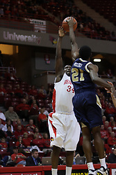 04 December 2010: Jordan Allou blocks a shot by Tony Lewis during an NCAA basketball game between the Montana State Bobcats and the Illinois State Redbirds at Redbird Arena in Normal Illinois.