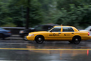 UNITED STATES-NEW YORK CITY-Central Park. PHOTO: GERRIT DE HEUS..VERENIGDE STATEN-NEW YORK. Taxi in een stortbui bij Central Park. PHOTO GERRIT DE HEUS
