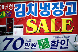 SOUTH KOREA MASAN 29OCT07 - Billboard advertising sale sign in downtown Masan, south Korea...jre/Photo by Jiri Rezac..© Jiri Rezac 2007..Contact: +44 (0) 7050 110 417.Mobile:  +44 (0) 7801 337 683.Office:  +44 (0) 20 8968 9635..Email:   jiri@jirirezac.com.Web:    www.jirirezac.com..© All images Jiri Rezac 2007 - All rights reserved.