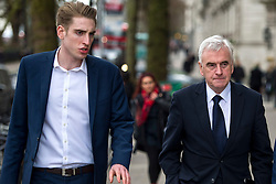 © Licensed to London News Pictures. 16/03/2016. London, UK. Shadow Chancellor JOHN MCDONNELL (right) with SEBASTIAN CORBYN, son of Jeremy Corbyn,  In Westminster on the day that George Osborne delivered his budget to parliament. Photo credit: Ben Cawthra/LNP