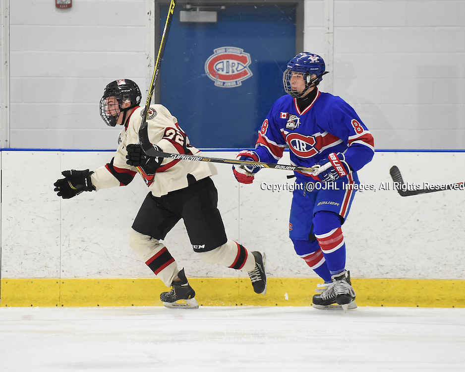 TORONTO, ON - Oct 17, 2015 : Ontario Junior Hockey League game action between Newmarket and Toronto, Nicholas Favaro #22 of the Newmarket Hurricanes battles for control with Lee Lapid #8 of the Toronto Jr. Canadiens during the third period.<br /> (Photo by Andy Corneau / OJHL Images)