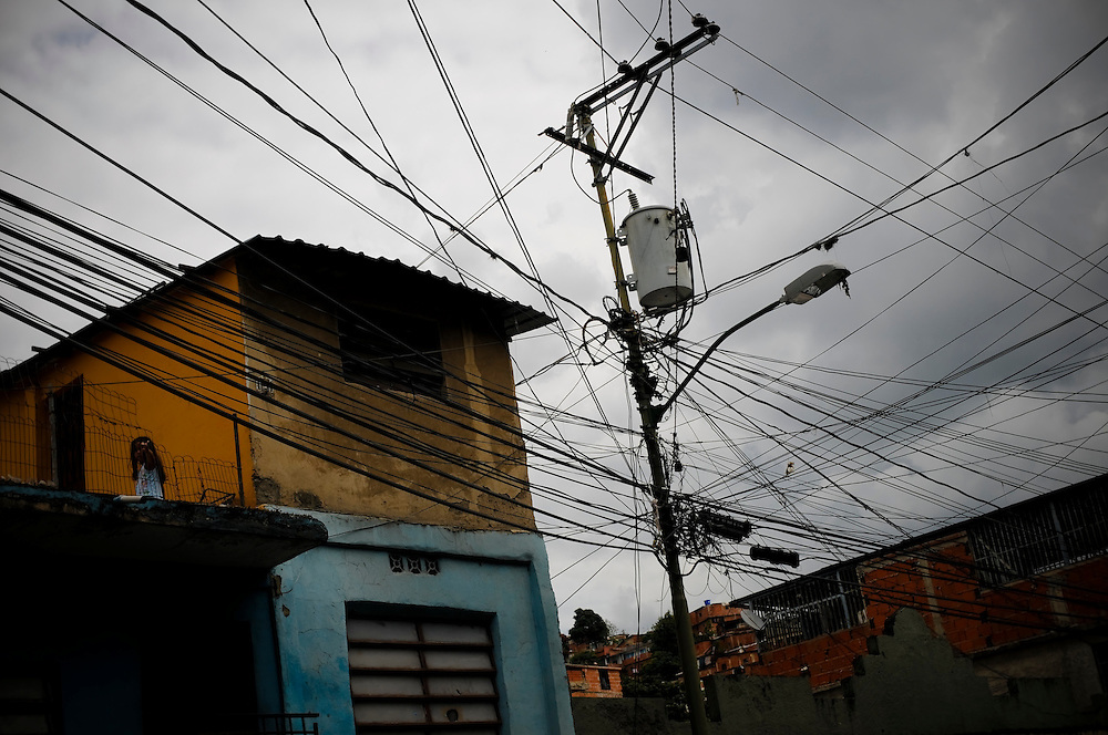 Power lines in Petare, a large slum in Caracas, Venezuela. President Chavez has initiated water and electricity rationing throughout the country, telling citizens that wasting electricity is a crime; and that they should limit showers to three minutes.