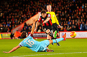 AFC Bournemouth midfielder Harry Arter shoots for goal and scores under pressure from West Ham Utd midfielder Mark Noble during the Barclays Premier League match between Bournemouth and West Ham United at the Goldsands Stadium, Bournemouth, England on 12 January 2016. Photo by Graham Hunt.