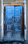 "Blue paint weathers, fades, and exfoliates on an old door in Huaraz, Peru, South America. Published in ""Light Travel: Photography on the Go"" book by Tom Dempsey 2009, 2010."
