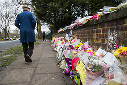 © Licensed to London News Pictures. 28/03/2018. Liverpool, UK. A man walks past rows of flowers and tributes left outside Ken Dodd's lifetime home in Knotty Ash on the morning of the funeral of comedian and performer Sir Ken Dodd , who died on 11th March 2018 at the age of 90 . Photo credit: Joel Goodman/LNP