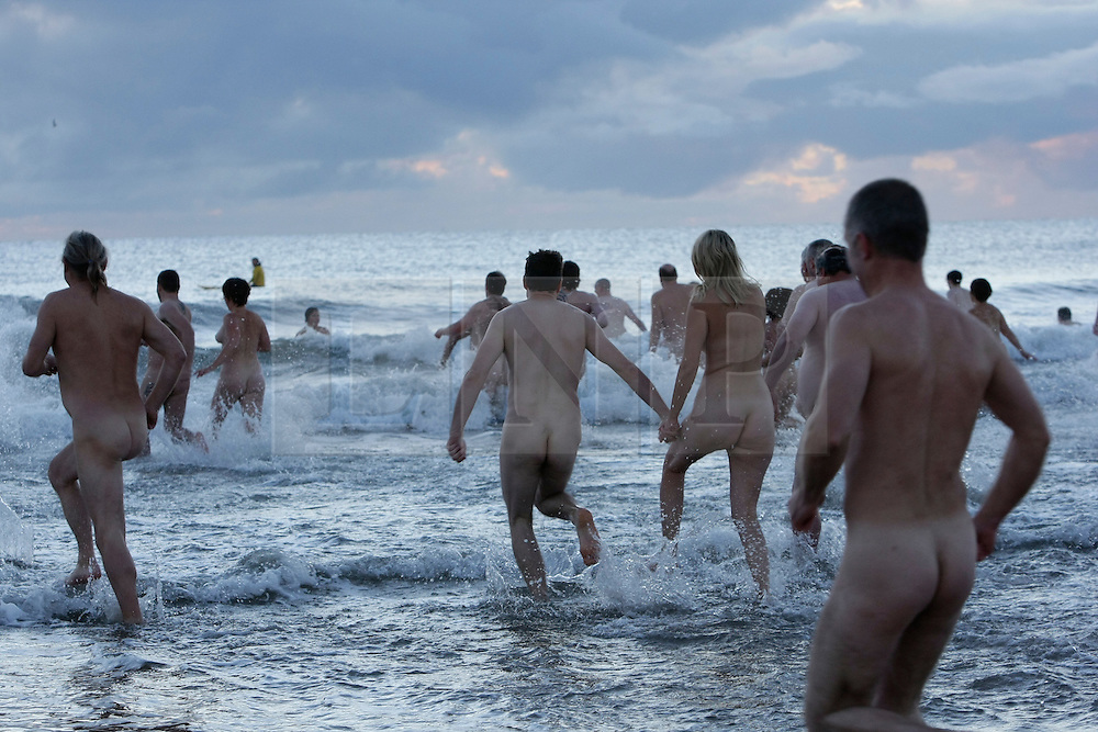 © Licensed to London News Pictures. 22/09/12 Druridge Bay Northumberland Bathers take to the chilly North sea to attempt to break the world record for skinny dipping and to raise money for the charity Mind at Druridge bay Northumberland. Photo credit : John Millard/LNP