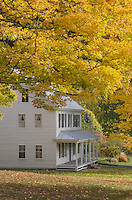 House framed by golden fall foliage, Sharon, Vermont