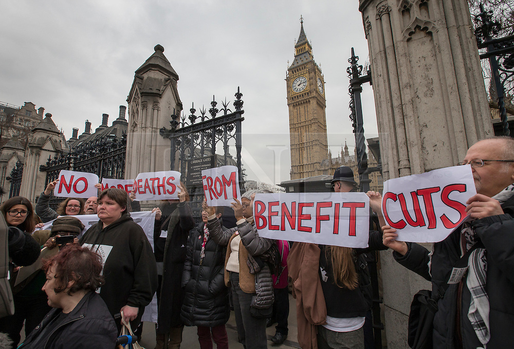 © Licensed to London News Pictures. 23/03/2016. London, UK. Disabled protestors rally outside Parliament after being ejected from Central Lobby where they were protesting  against government cuts to benefits.  Photo credit: Peter Macdiarmid/LNP