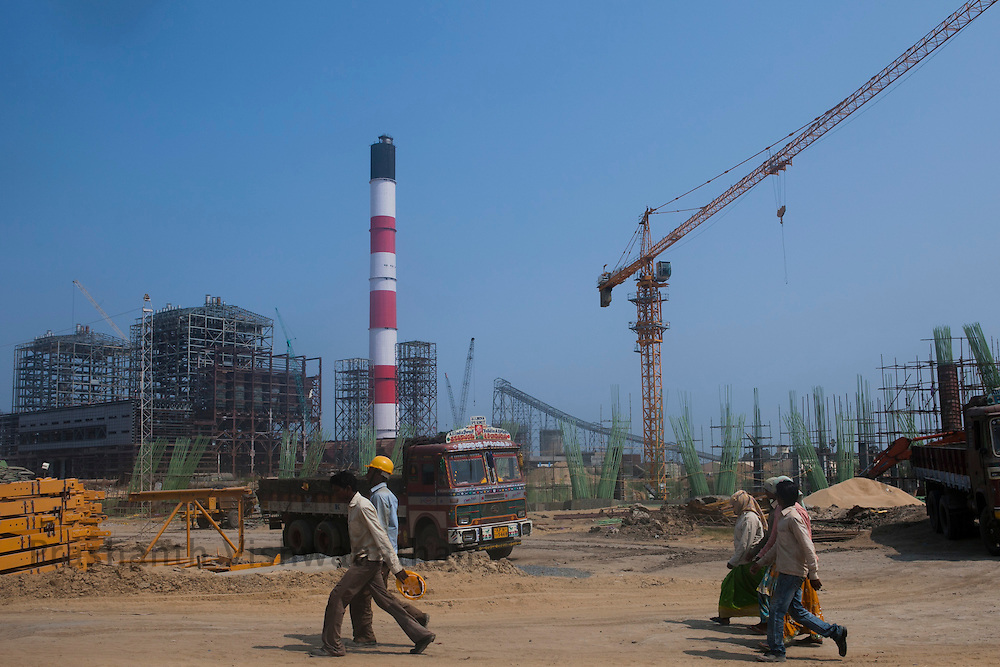 Workers walk past a semi-constructed power plant AP GENCO, in Nellore District, Andhra Pradesh, India, on Friday April 6, 2012. Of its many economic challenges, one of the biggest holding India back is energy. In the last year, the problem has grown acute with the gap between demand and supply jumping to 10.2 percent last month, from 7.7 percent a year earlier. In some states like Andhra Pradesh, where Nellore is located, and in neighboring Tamil Nadu, blackouts have become so common that many factories report getting more electricity from diesel generators than they do from the power grid at a cost that is roughly three times higher. Photographer: Prashanth Vishwanathan/NYT, in Nellore District, Andhra Pradesh, India, on Friday April 6, 2012. Of its many economic challenges, one of the biggest holding India back is energy. In the last year, the problem has grown acute with the gap between demand and supply jumping to 10.2 percent last month, from 7.7 percent a year earlier. In some states like Andhra Pradesh, where Nellore is located, and in neighboring Tamil Nadu, blackouts have become so common that many factories report getting more electricity from diesel generators than they do from the power grid at a cost that is roughly three times higher.Photographer: Prashanth Vishwanathan