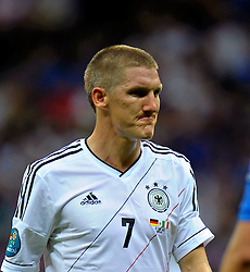 A dejected Bastian Schweinsteiger during the UEFA EURO 2012 semi final match between Germany and Italy at the National Stadium on June 28, 2012 in Warsaw, Poland.