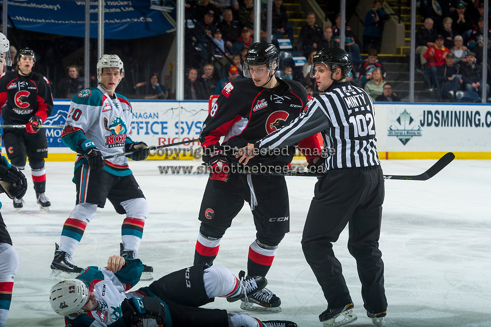 KELOWNA, CANADA - MARCH 14: Linesman Dustin Minty gets between Jackson Leppard #8 of the Prince George Cougars and Erik Gardiner #12 of the Kelowna Rockets on March 14, 2018 at Prospera Place in Kelowna, British Columbia, Canada.  (Photo by Marissa Baecker/Shoot the Breeze)  *** Local Caption ***