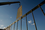 The 115th Group of the Utah National Guard erects a barrier fence along the US-Mexico border near San Luis, AZ on Wednesday, June 7, 2006.<br />