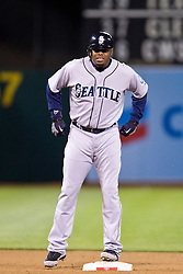 April 5, 2010; Oakland, CA, USA;  Seattle Mariners right fielder Ken Griffey Jr. (24) hit a double during the eighth inning against the Oakland Athletics at Oakland-Alameda County Coliseum. Seattle defeated Oakland 5-3.