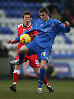 Photo: Paul Thomas.<br /> Macclesfield Town v Swindon Town. Coca Cola League 2. 23/12/2006.<br /> <br /> Macclesfield's Kevin McIntyre gets away from Lucas Jutkiewicz.