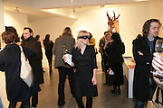 Waitress, Moving Picture. Exhibition of work by Marcel Dzama. Timothy Taylor Gallery.  Dering St. London. 7 March 2007.  -DO NOT ARCHIVE-© Copyright Photograph by Dafydd Jones. 248 Clapham Rd. London SW9 0PZ. Tel 0207 820 0771. www.dafjones.com.