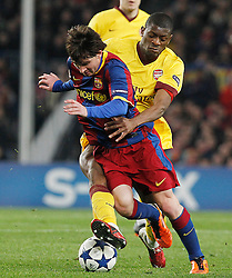 FC Barcelona's Leo Messi (f) and Arsenal's Emmanuel Eboue during UEFA Champions League match.March 8,2011.