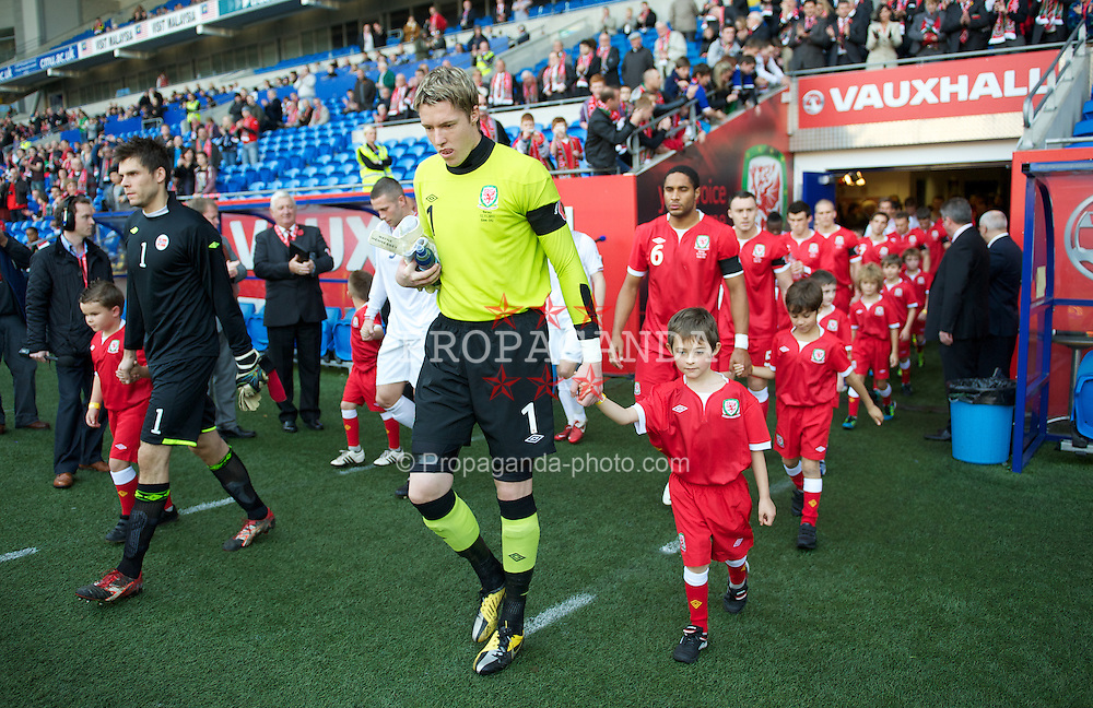 CARDIFF, WALES - Saturday, November 12, 2011: Wales' goalkeeper Wayne Hennessey walks out to face Norway during the international friendly match at the Cardiff City Stadium. (Pic by David Rawcliffe/Propaganda)