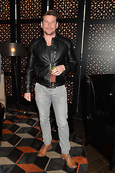 GARY COCKERILL at a party to celebrate the publication of Behind The Mask by Emma Sayle held at The Playboy Club, 14 Old Park Lane, London on 23rd April 2014.